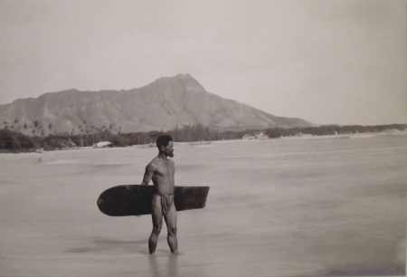 Hawaiian with surfboard and Diamond Head in the background-(WC)-c. 1890-450
